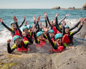 What is coasteering? Group picture in the shell bay hot tub