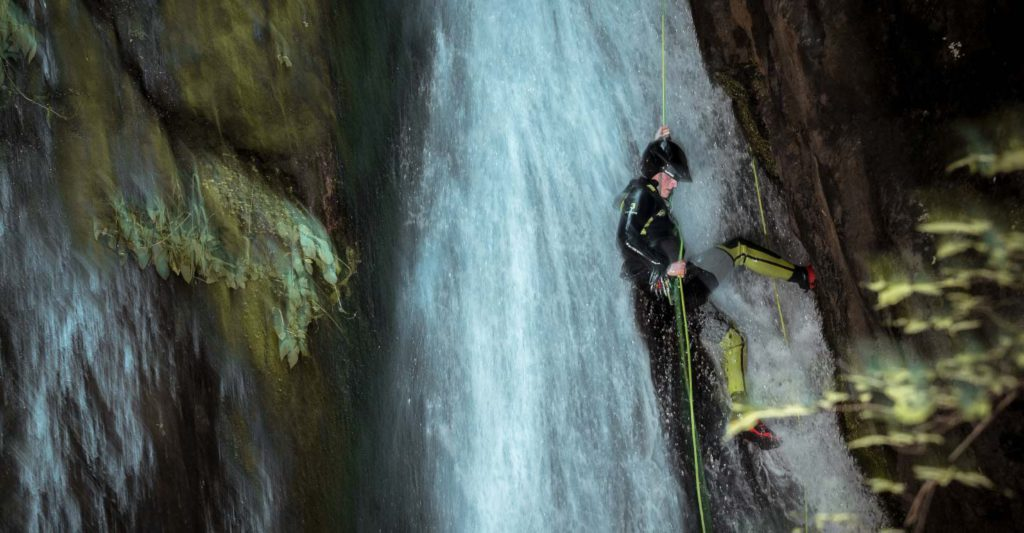 Abseiling the final waterfall of the awesome Alva Cayon